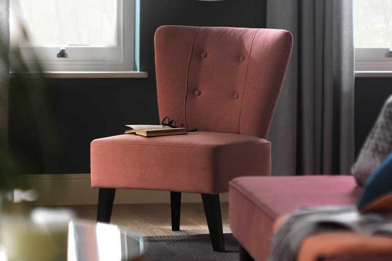 Habitat Delilah fabric cocktail chair in pink with button back detailing.