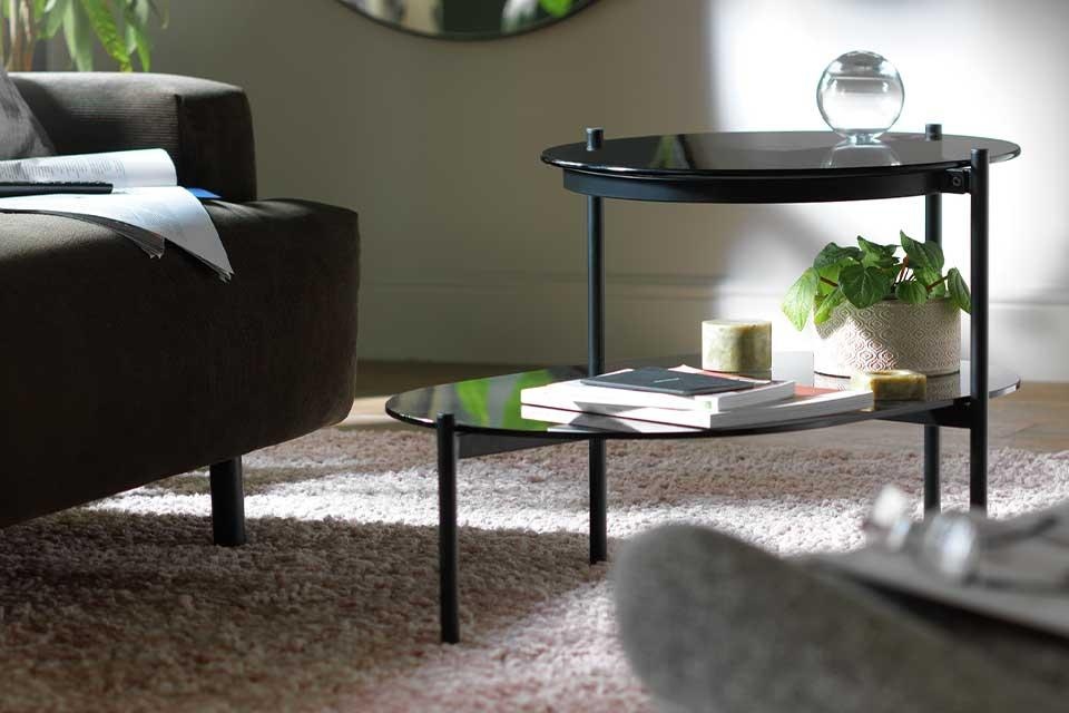 Habitat Neo tiered black side table in a lounge setting.