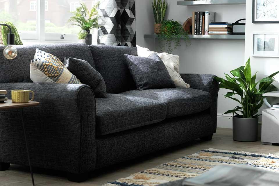 Charcoal Habitat Lisbon 4 seater sofa in a modern lounge setting.