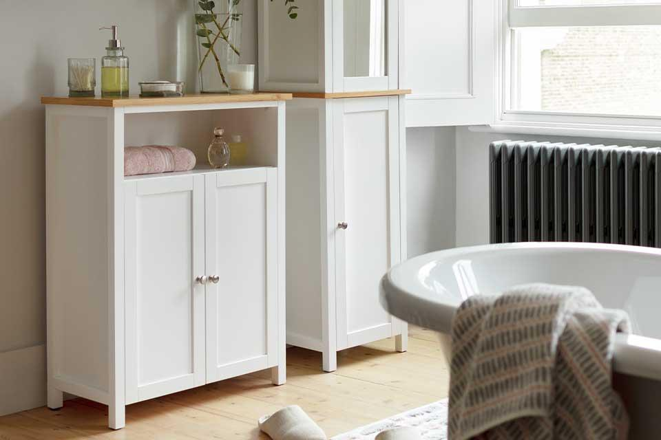 The Argos Home Livingston 2-door bathroom cabinet and tallboy in a bathroom setting.