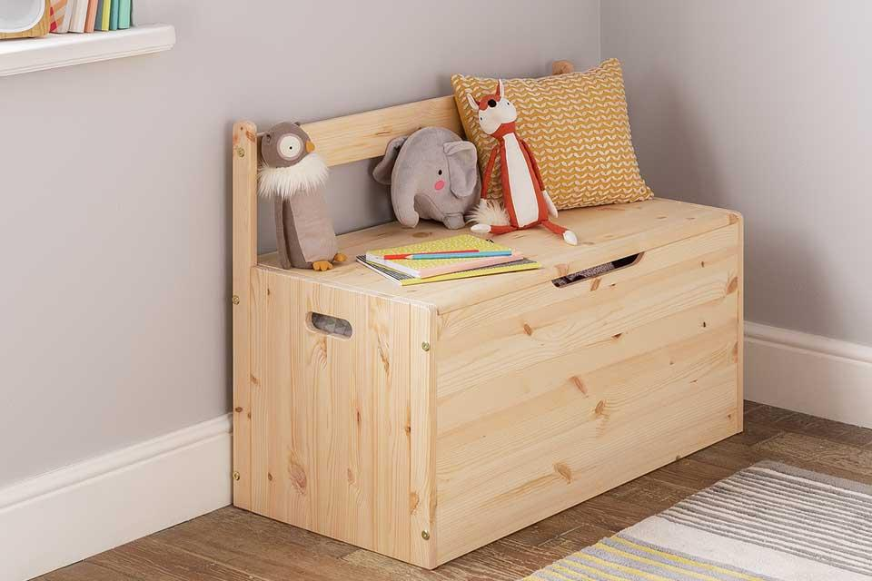 Pine large Argos Home Scandinavia toy box with cuddly toys on top.