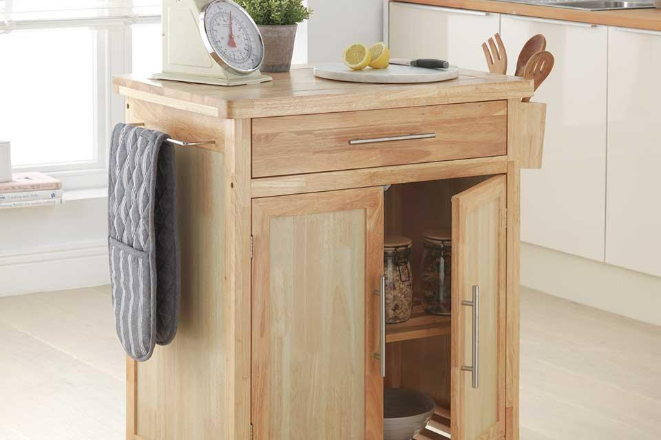 Argos Home Tollerton wooden kitchen trolley filled with kitchen accessories.