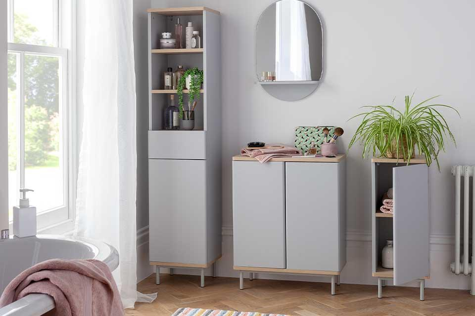 The grey Habitat Freja tallboy, 1-door cabinet and 2-door cabinet in a bathroom.