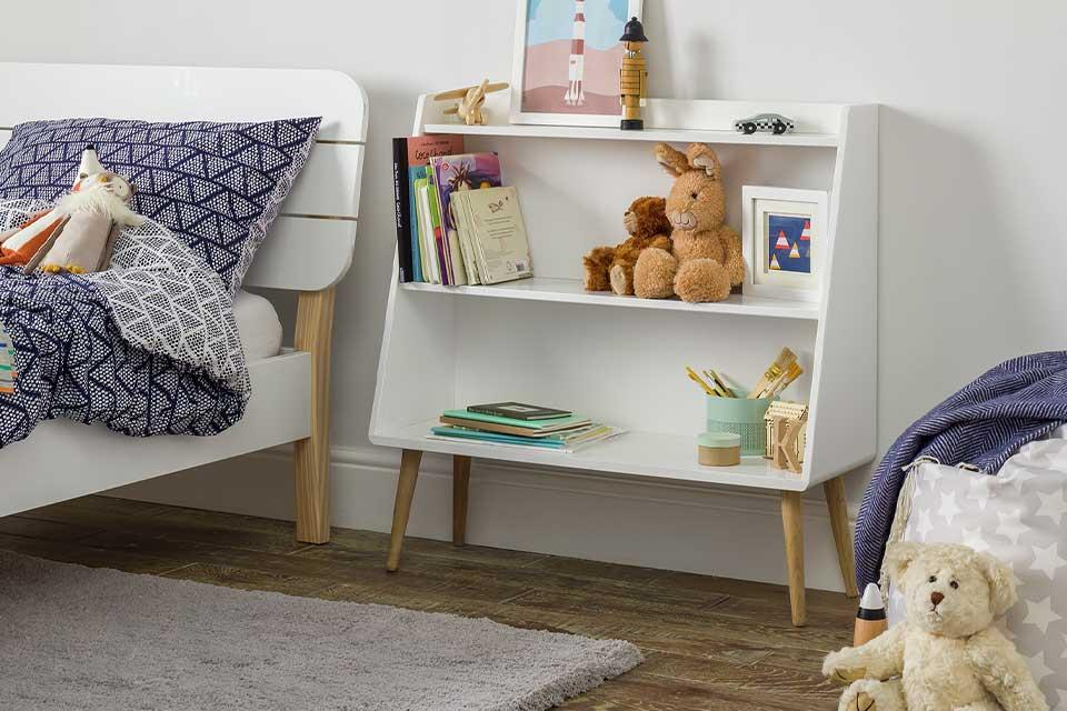 Brilliant bookcases.Argos Home Bodie white bookcase with Scandi-splayed legs in a kid's room.