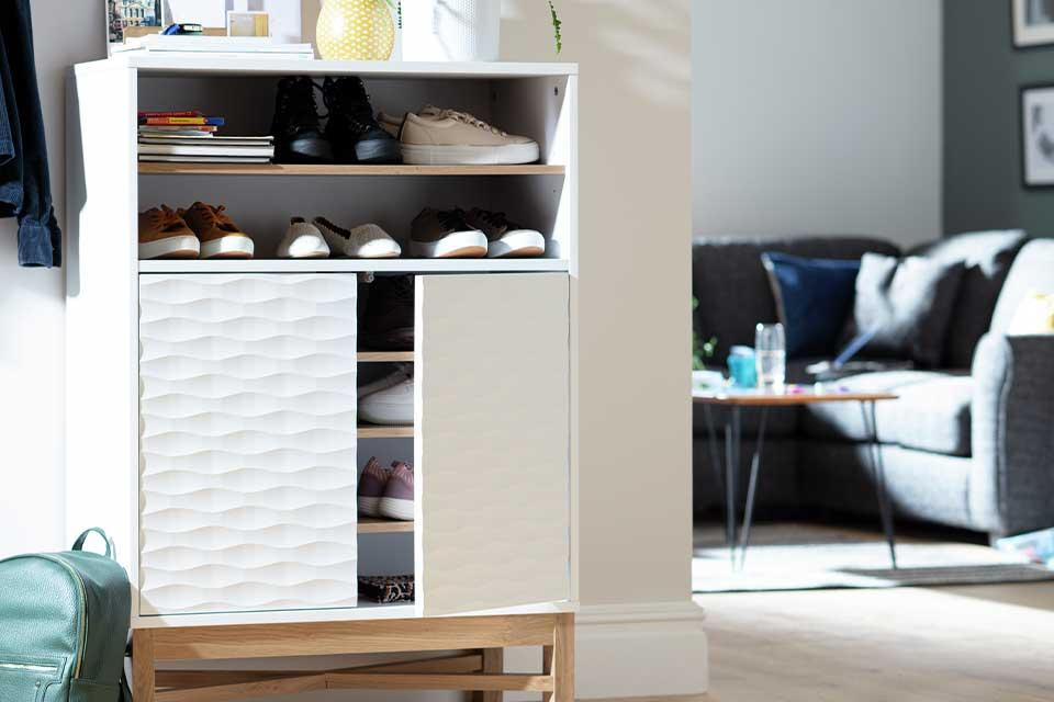 The Habitat Zander white unit with a textured front being used to store shoes in a hallway.