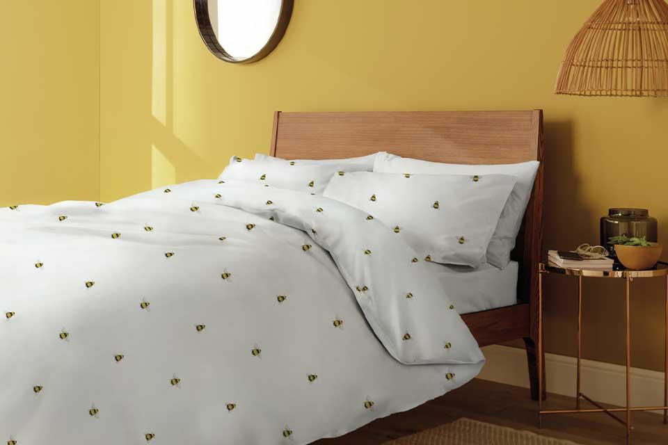 Argos Home Country Hideaway Bee repeat print duvet cover in white.