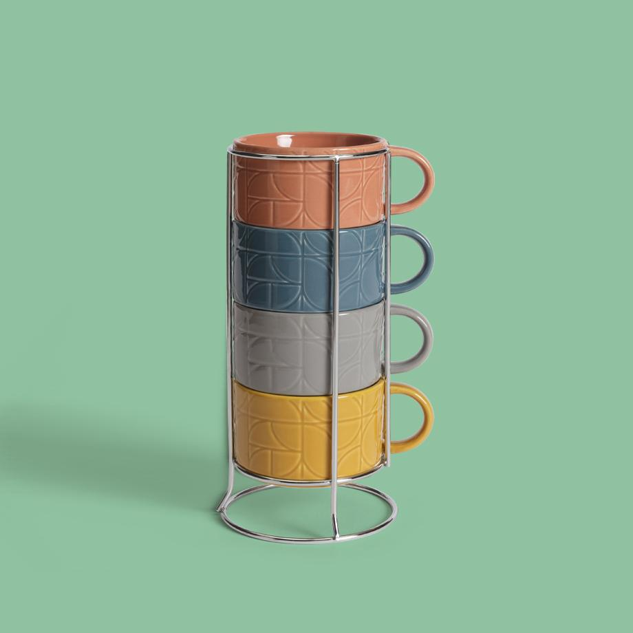 Four stacked cups in a metal holder.