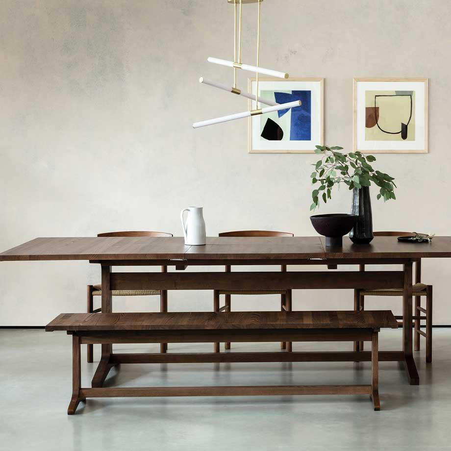 The Habitat Parker extendable table in walnut stain with two dining benches.