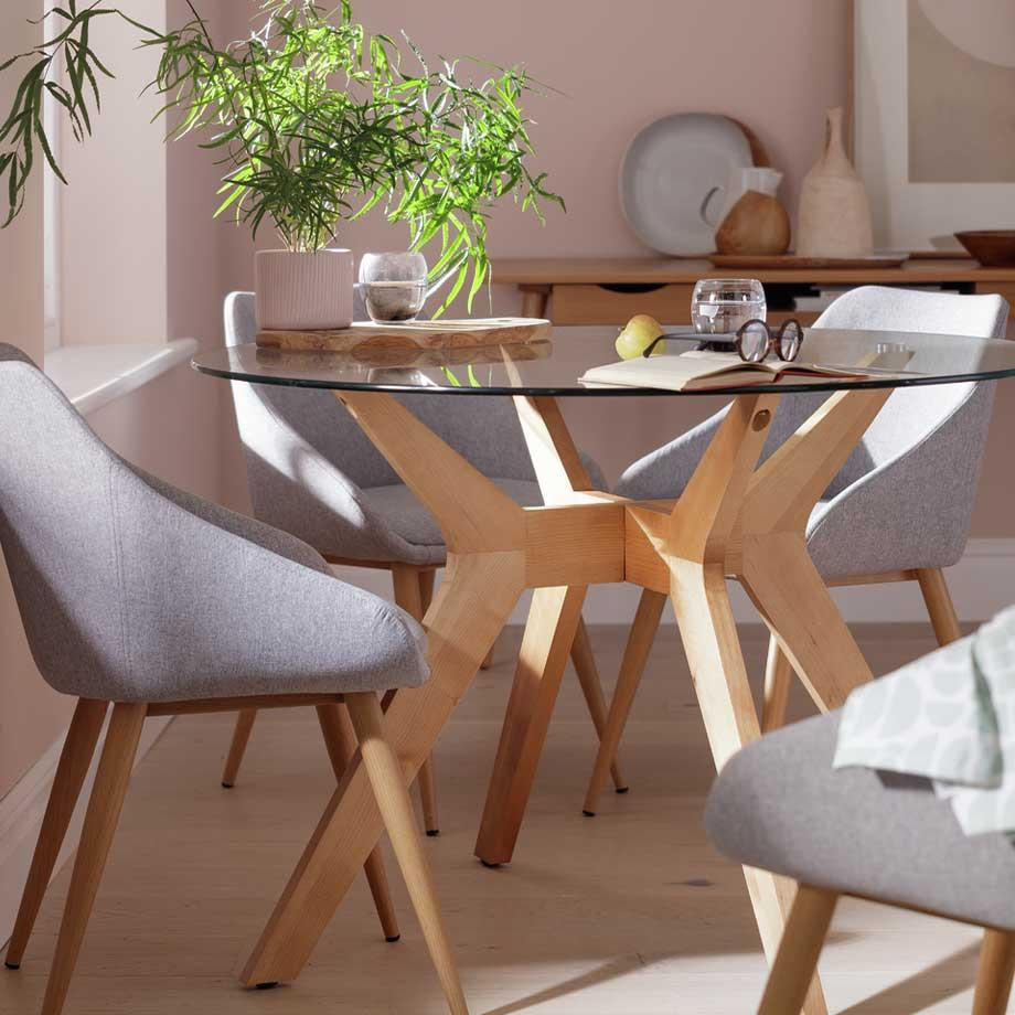 The Habitat Zela New Century round dining table with grey dining chairs.