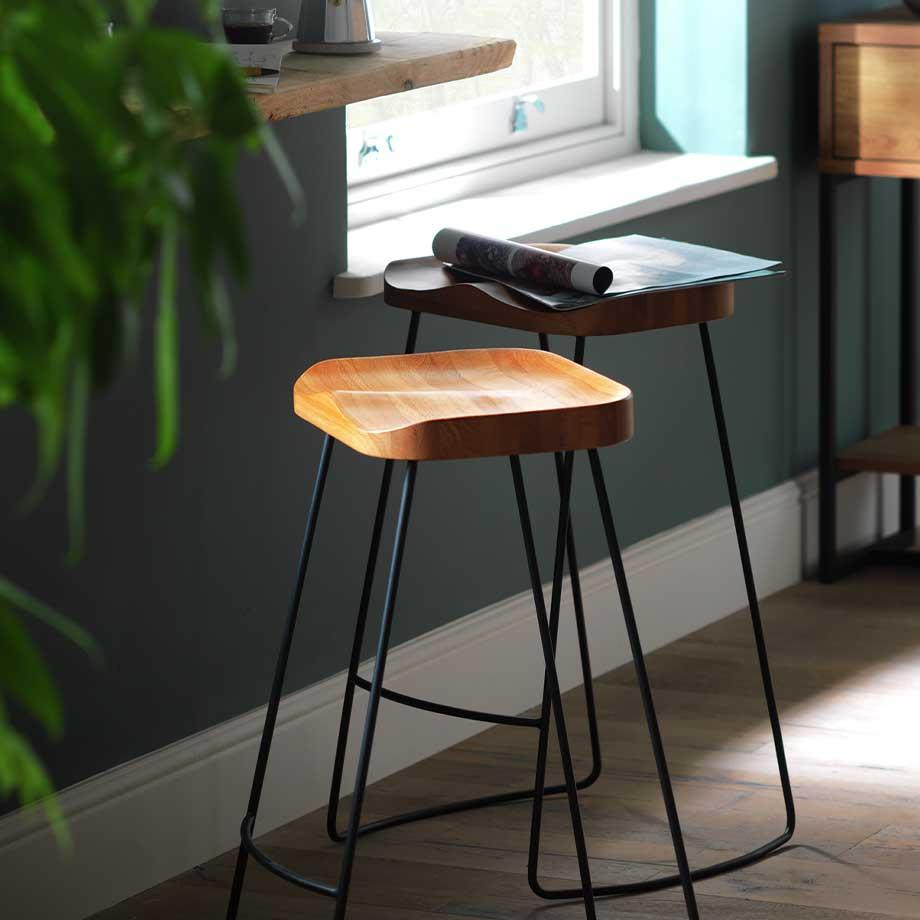 Two oak Habitat Arte bar stools with metal legs in a room setting.