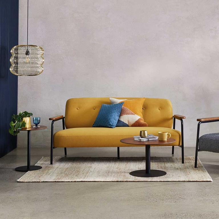 The yellow Habitat Cooper 2-seater sofa in a modern lounge.