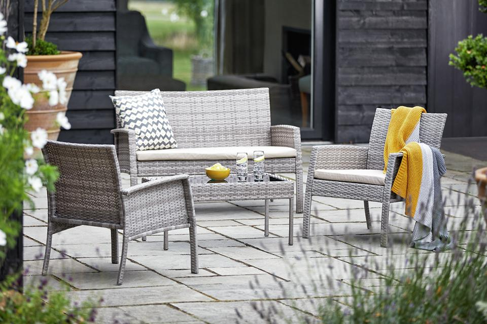 Grey sofa and chair patio set.