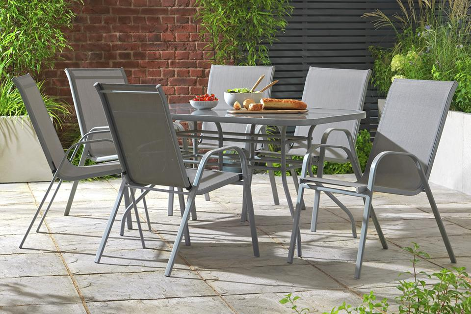 A grey metal patio set with 6 chairs.