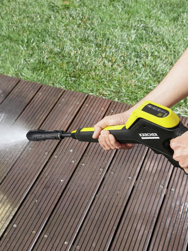 Karcher K4 power control pressure washer, being used to clean decking.