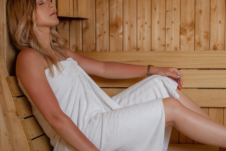 Woman in towel in  a steam room.