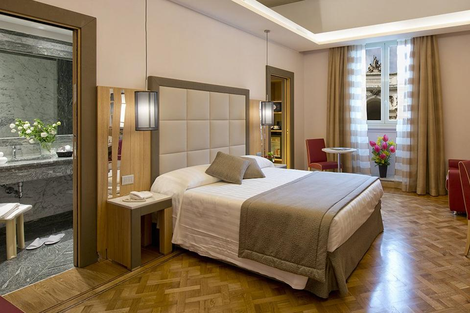 A hotel bedroom room with ensuite.