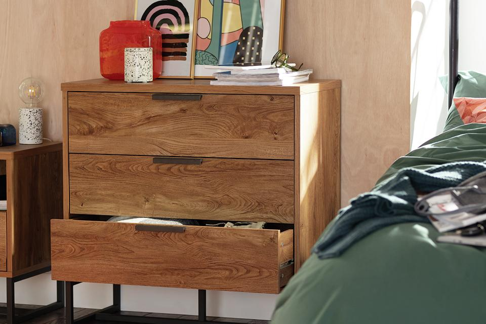 Mid century style chest of drawers in a bedroom.