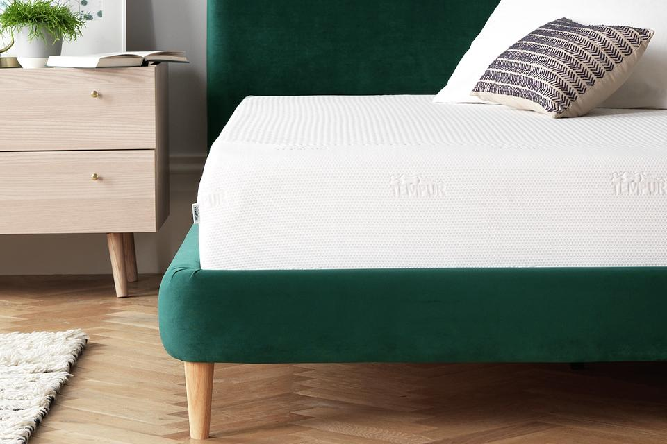 Green velvet bed with tempur mattress.