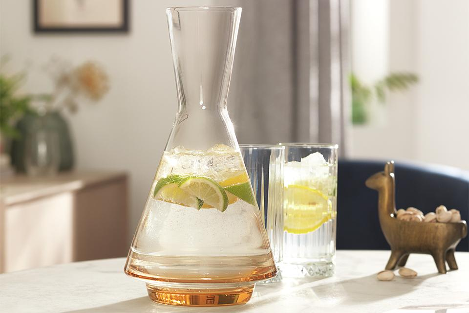 Glass carafe, with lime water in it.