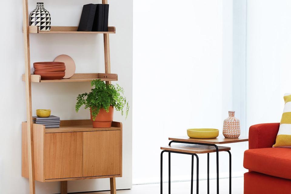 A wooden ladder shelf bookcase in oak.
