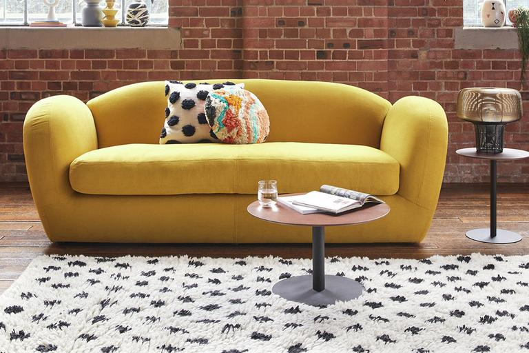 A yellow velvet sofa.