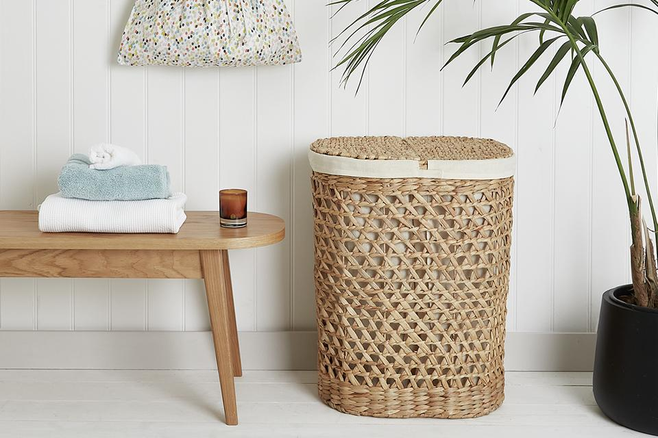 Image of a bathroom with a basket and hanging storage.