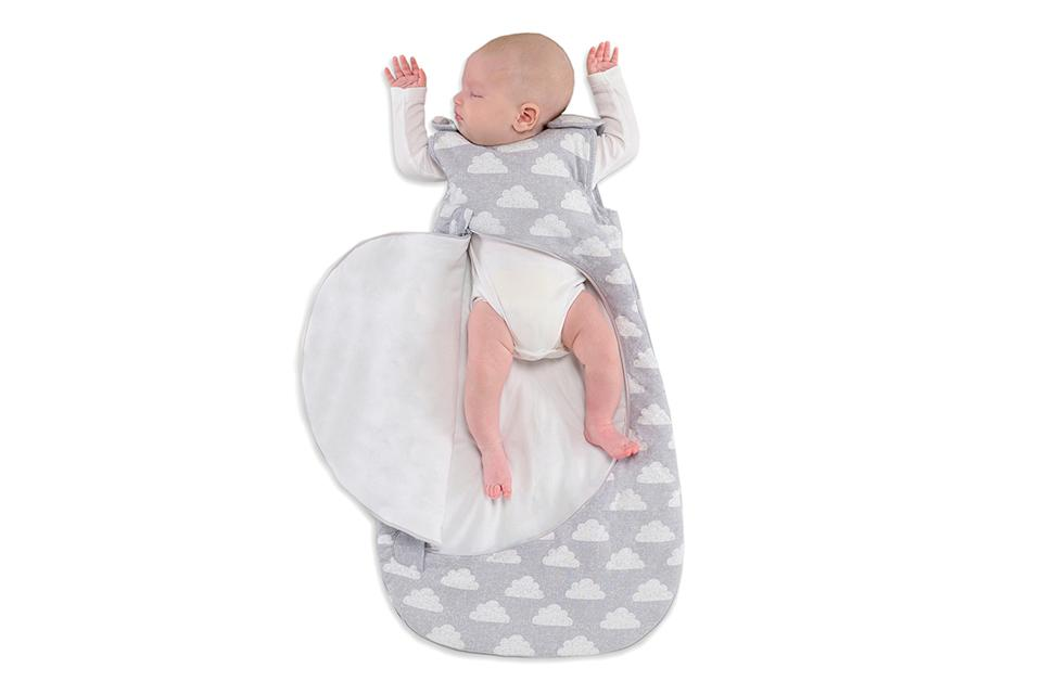A newborn baby in a sleeping bag.