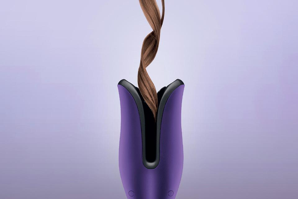A section of hair curled using the purple Glamoriser Instant Auto Curler.