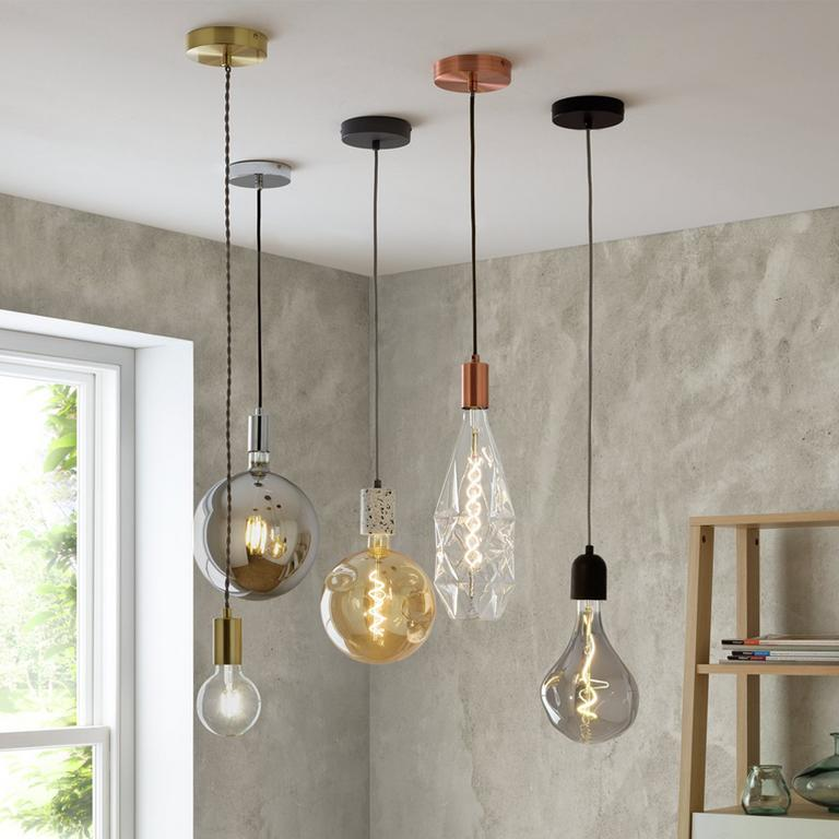 Image of a cluster of pendant lights in different shapes and colours.