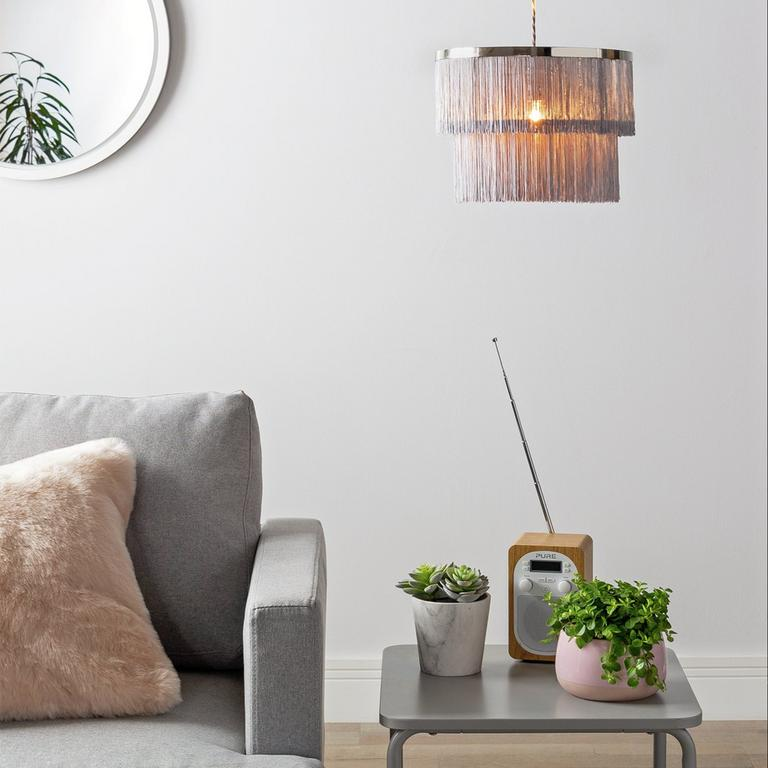 Image of a chrome and pink fringed pendant light.