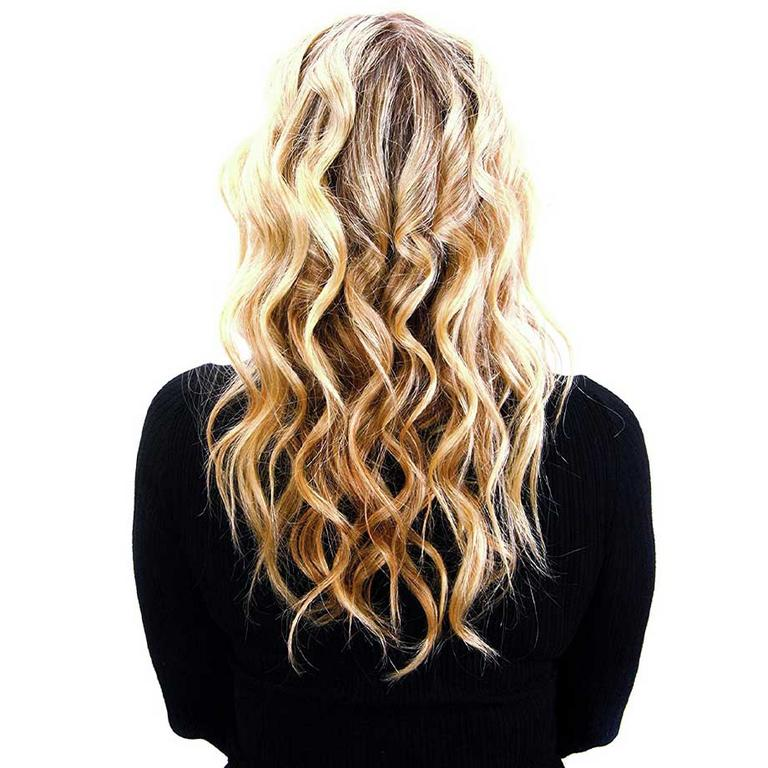 The back of a woman's head with blonde beachy waves.