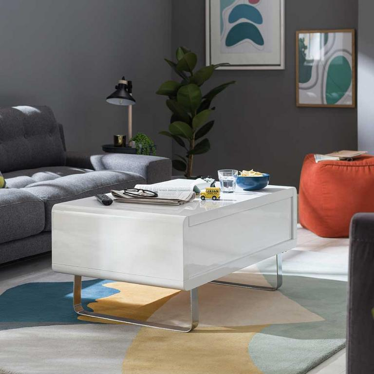 The white Habitat Sleigh gloss gas lift coffee table in a modern lounge.