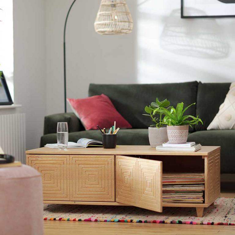 The oak Habitat Grooved Storage coffee table in a modern lounge setting.