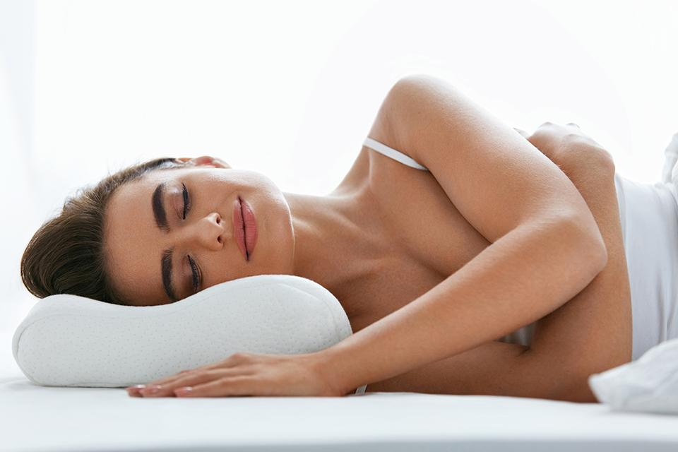 Woman laying on pillow.