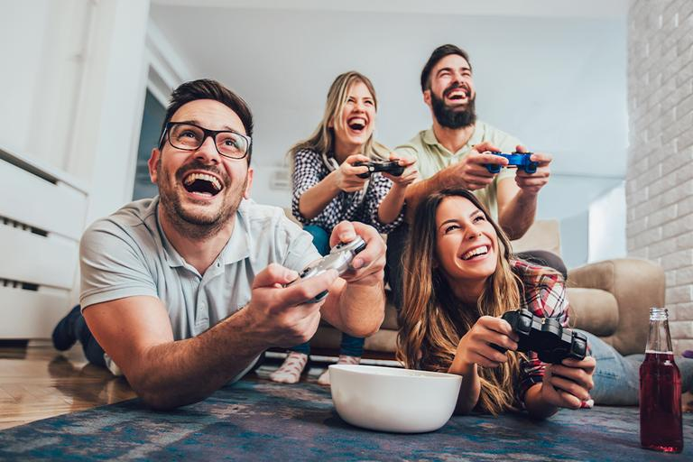 A group of friends play video games.