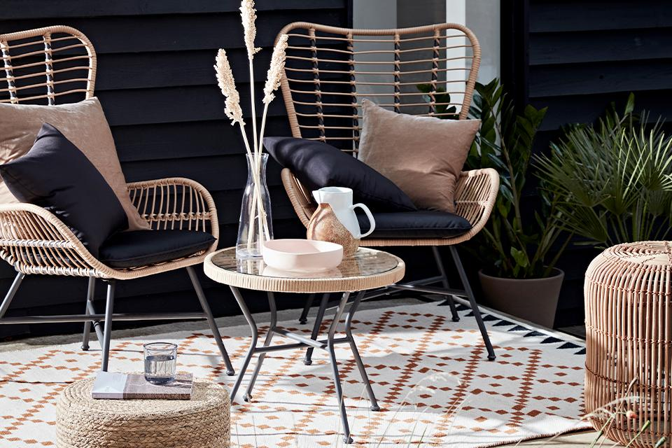 Rattan and metal garden chairs and coffee table.