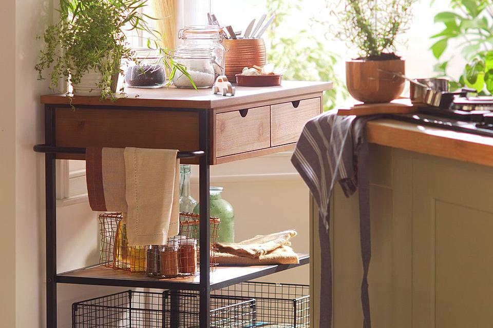 Kitchen trolley with accessories in kitchen setting.