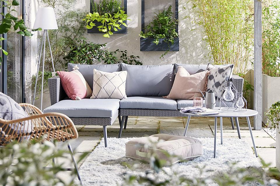 Grey corner garden sofa on patio.