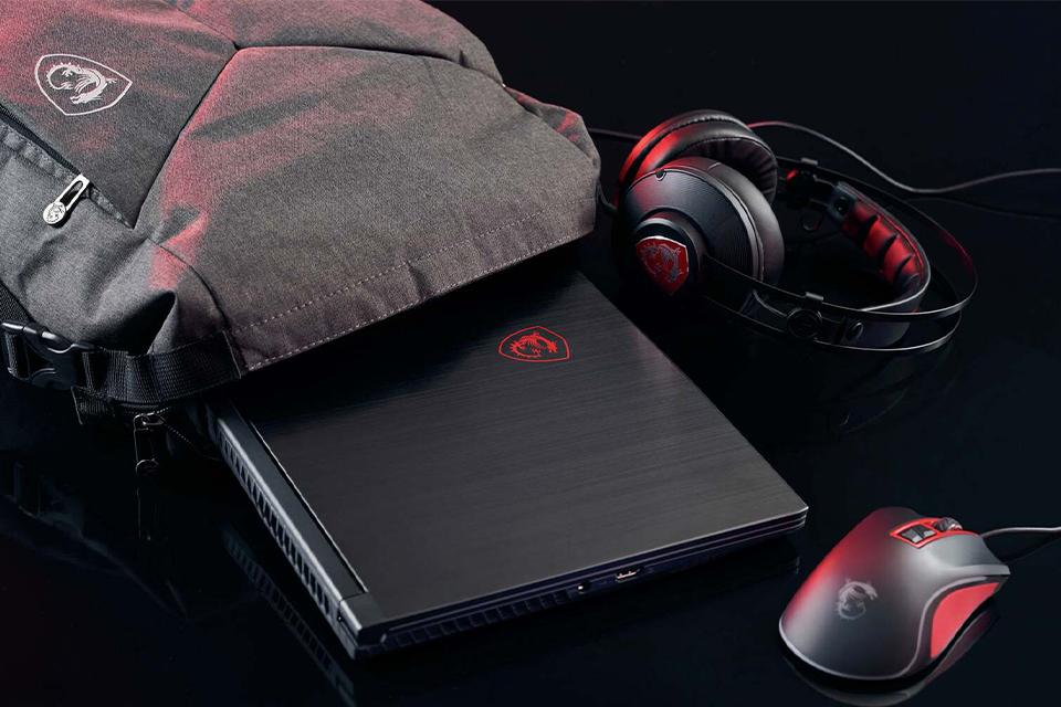 A gaming laptop, mouse and headset and a laptop bag.