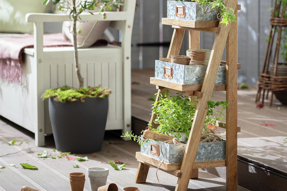 A ladder planter on a patio.