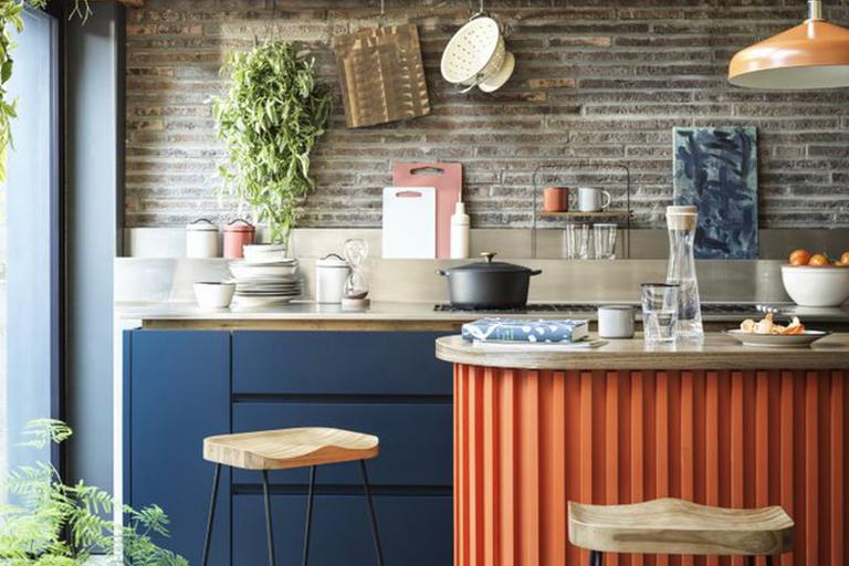 Modern orange and blue kitchen.