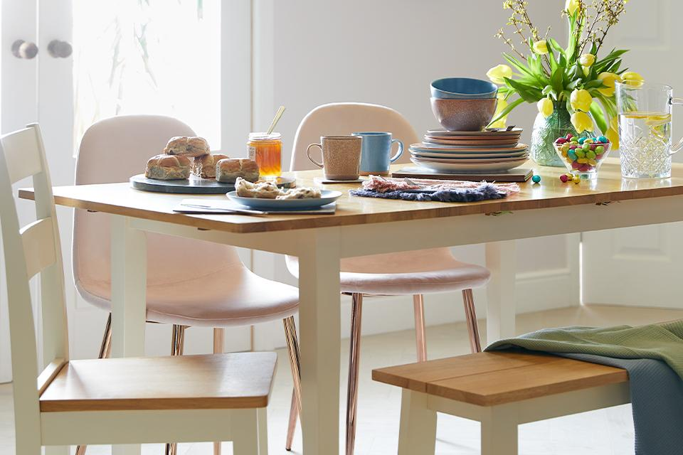Table with chair sets, bench, and tableware.