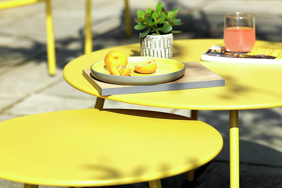 Yellow metal garden chair and table set.