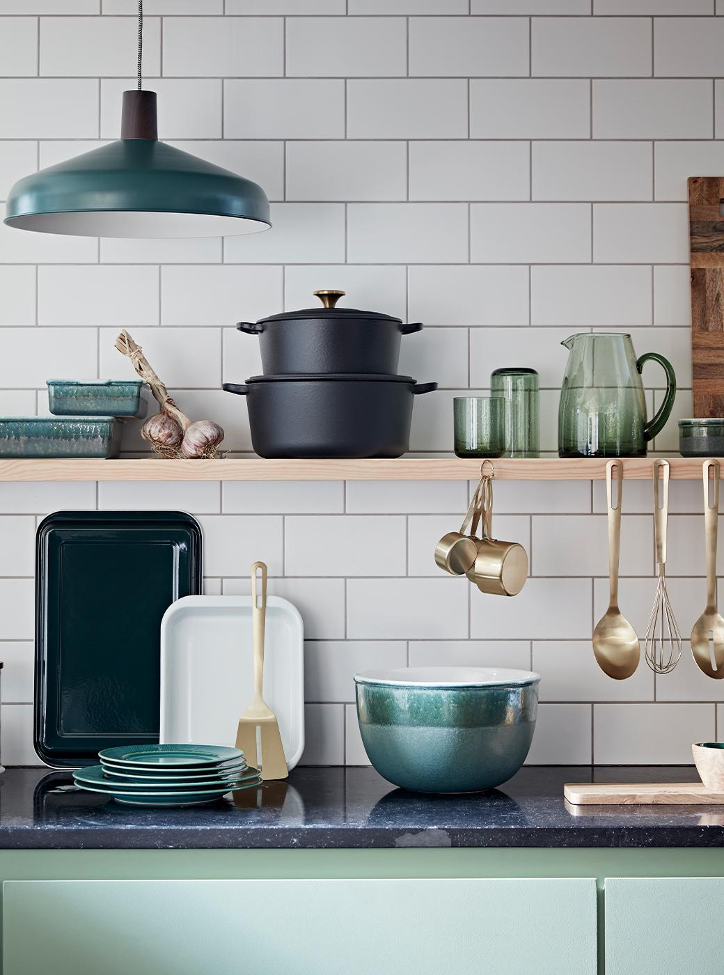 Teal and green kitchen with kitchen accessories.