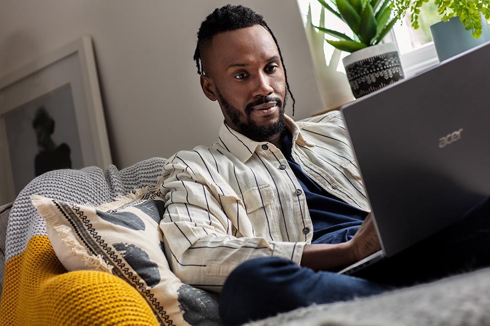 A man shops using his laptop.