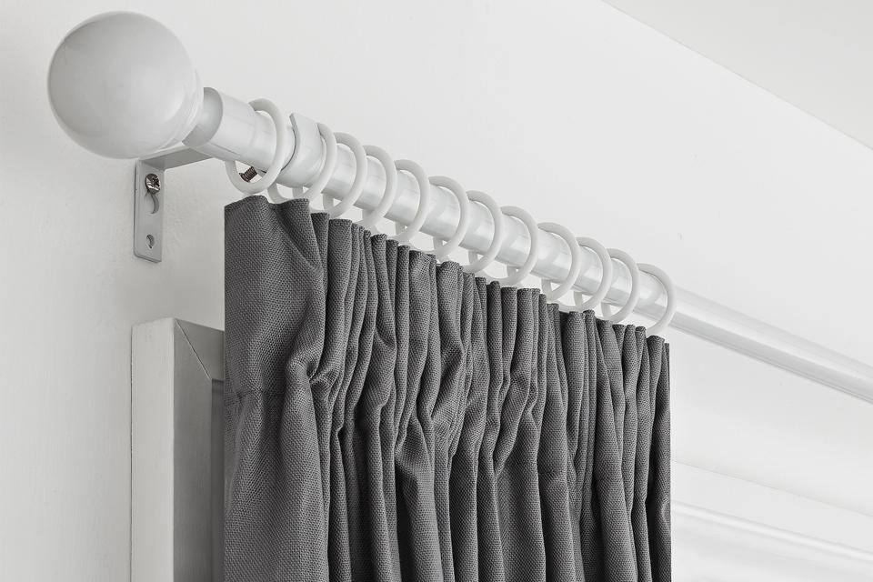 How to put up a curtain pole or track.