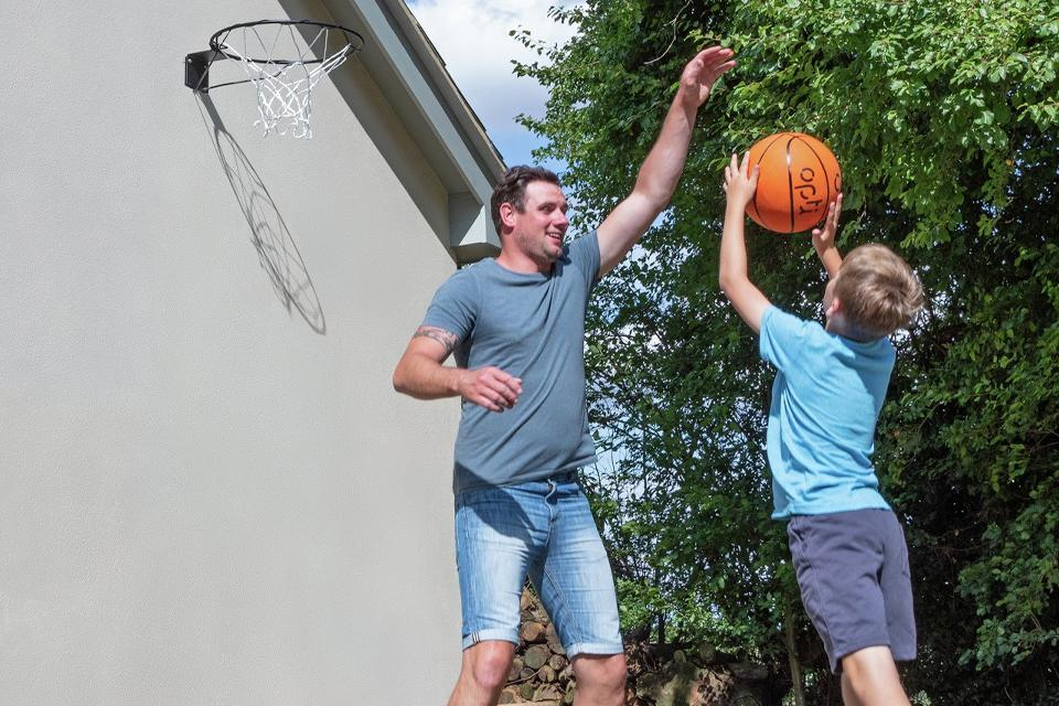 Father and son playing basketball.