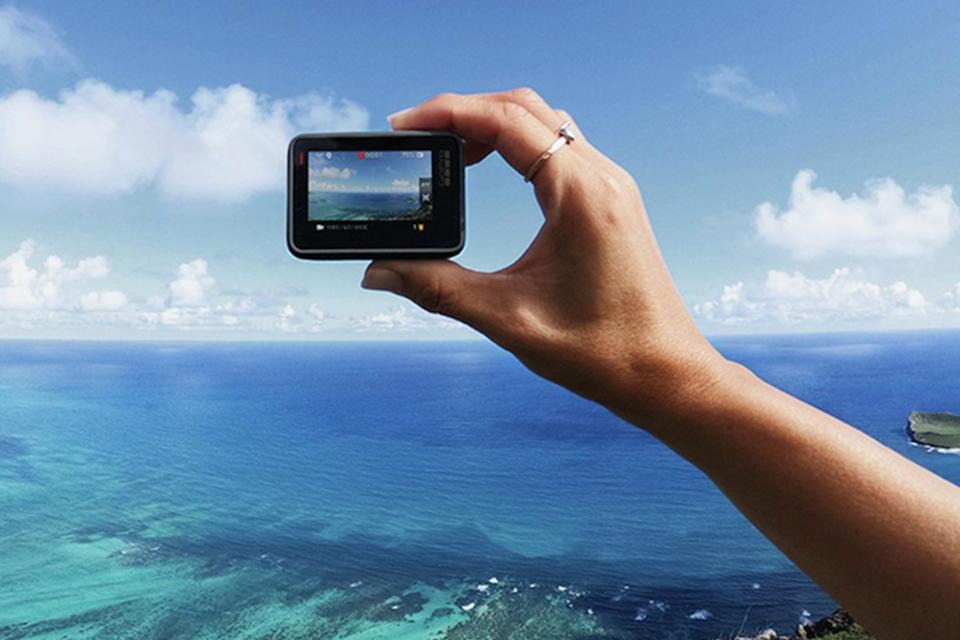 A small digital camera is shown viewing the ocean.