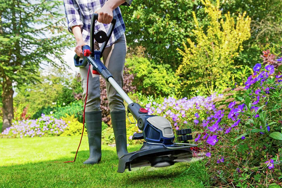Man using grass trimmer.