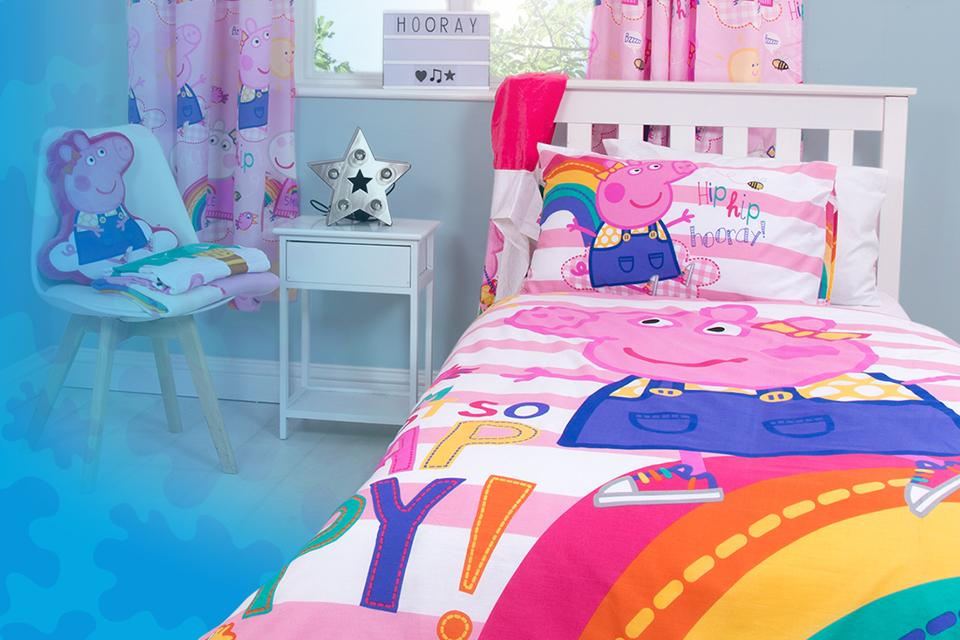 Child's bedroom styled with Peppa Pig homewares including a bedding set and curtains.